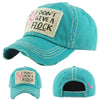 Slightly distressed I Don't Give a Flock Hat Turquoise with white stitching and white patch with Pink Flamingo and I don't give a flock on it.  Small pink flamingo on back of hat