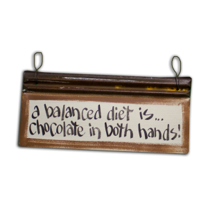 A Balanced Diet Is Chocolate in Both Hands Sign
