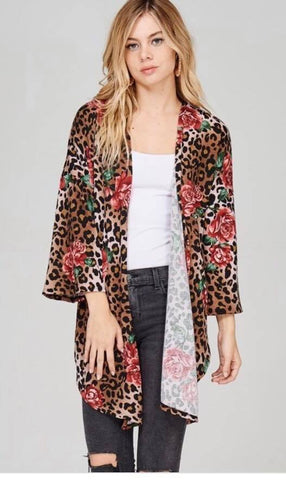 Front view of woman wearing leopard floral kimono