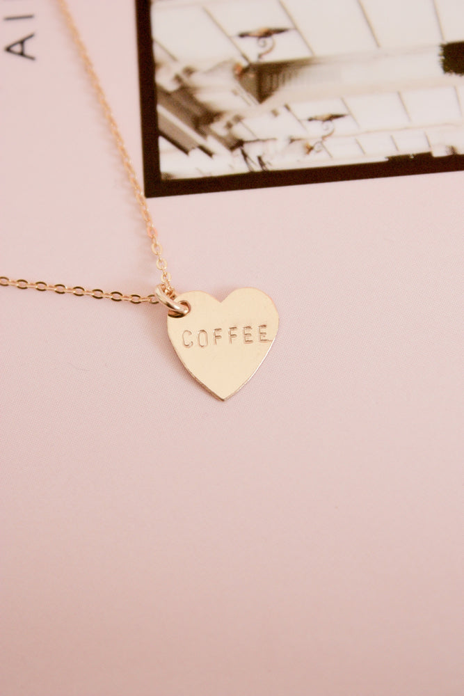 Mini gold heart charm necklace hand stamped with the word coffee