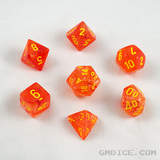 Orange glow-in-the-dark DnD dice with the lights on.