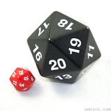 A big black die compared in size to an average-sized red die.