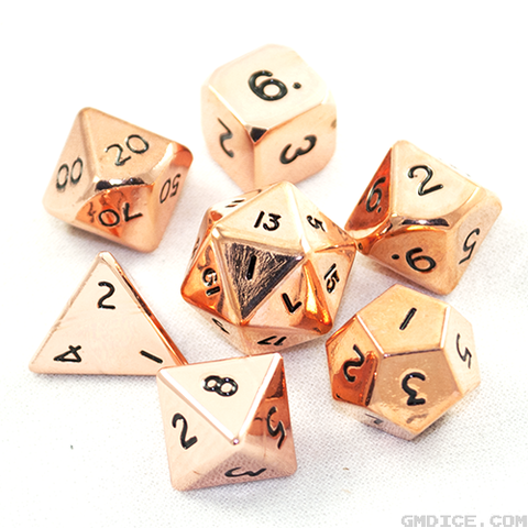 A set of seven polyhedral dice, made out of metal with a lustrous, shiny copper finish.