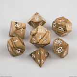 Zebra wood dice against a white background