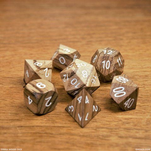 Zebra wood dice against a wood background