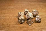 Zebra wood dice on a wood kitchen table