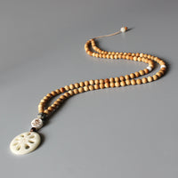 Tibetan Buddhist Mala Bead Necklace with Hand Carved Tagua Nut Pendant