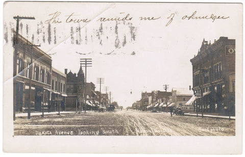 SD, Huron - Dakota Ave with signs - Root RPPC postcard - F09054