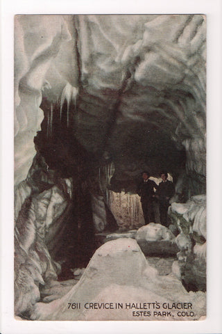 CO, Estes Park - Crevice in Halletts Glacier, men inside - B17043
