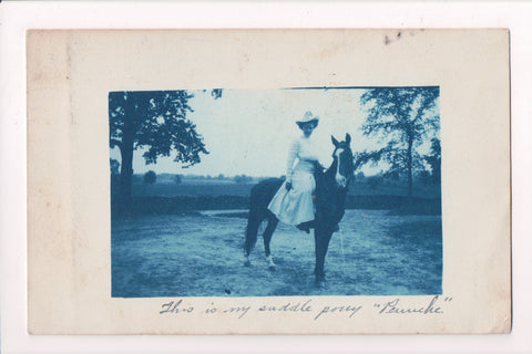People - Female - Cyanotype - @1909 Real Photo Postcard of a lady with dress on pony - w04