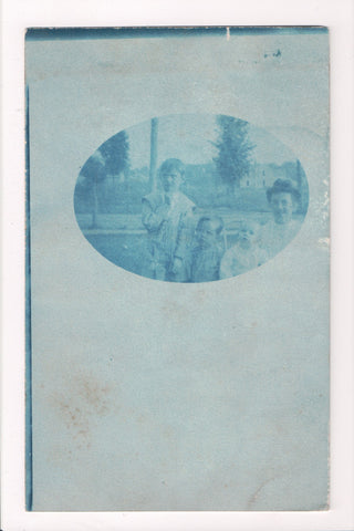 People - Family postcard - mother, 3 kids in wide oval shape - rppc cyanotype - w04143