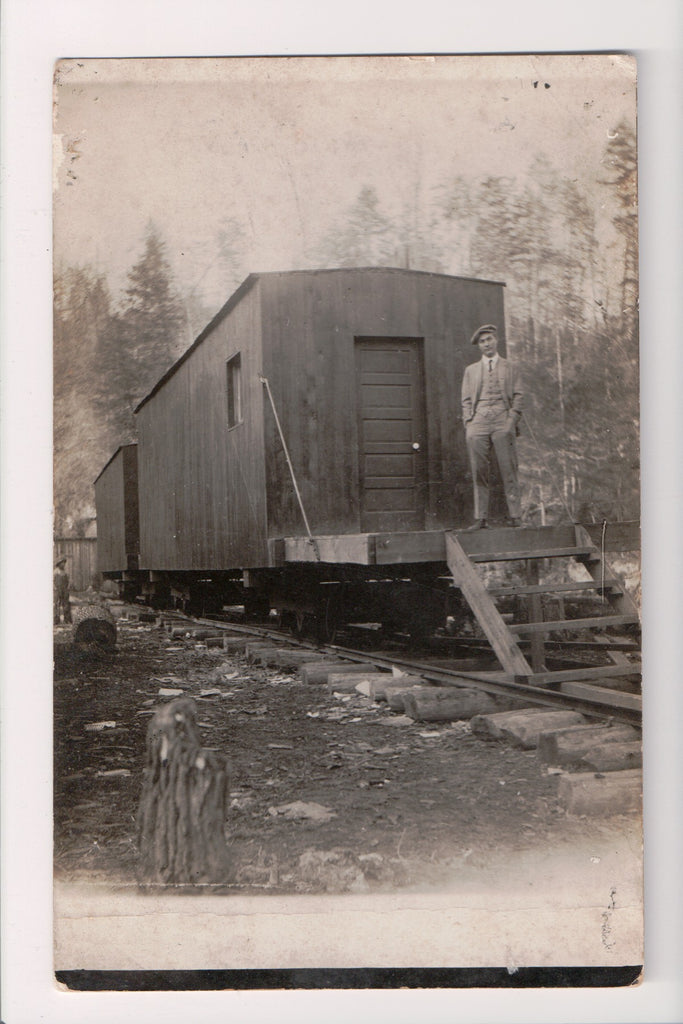 Train - Railroad - stationary cars on hand hewn RR Ties, Man - RPPC - E17042