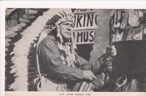 Indian postcard - Caughnawaga Chief Poking Fire - CP0458