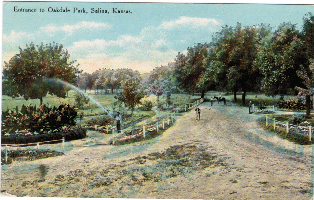 KS, Salina - Oakdale Park entrance, man watering - A12509
