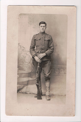 MISC - Military Man in uniform, cross on pocket, rifle in hand - RPPC - D06139