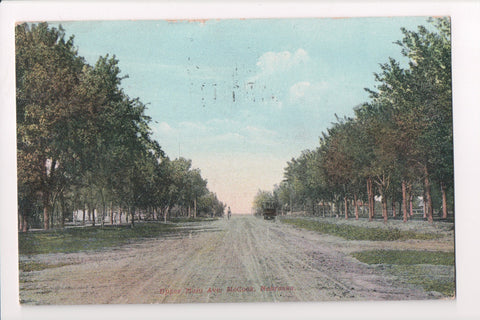 NE, McCook - Upper Main Ave, man on bike - mailed 1910 - C17375
