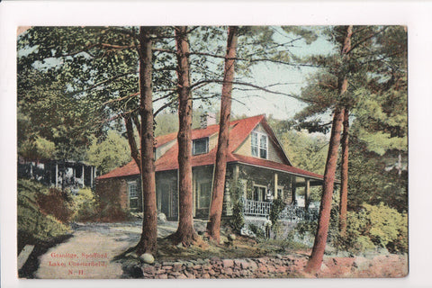 NH, Chesterfield - Lake Spofford - Granitge, person on porch - D05354