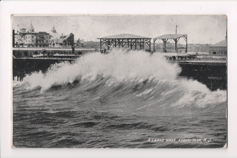 NJ, Asbury Park - Wave breaking with buildings shown - w00553