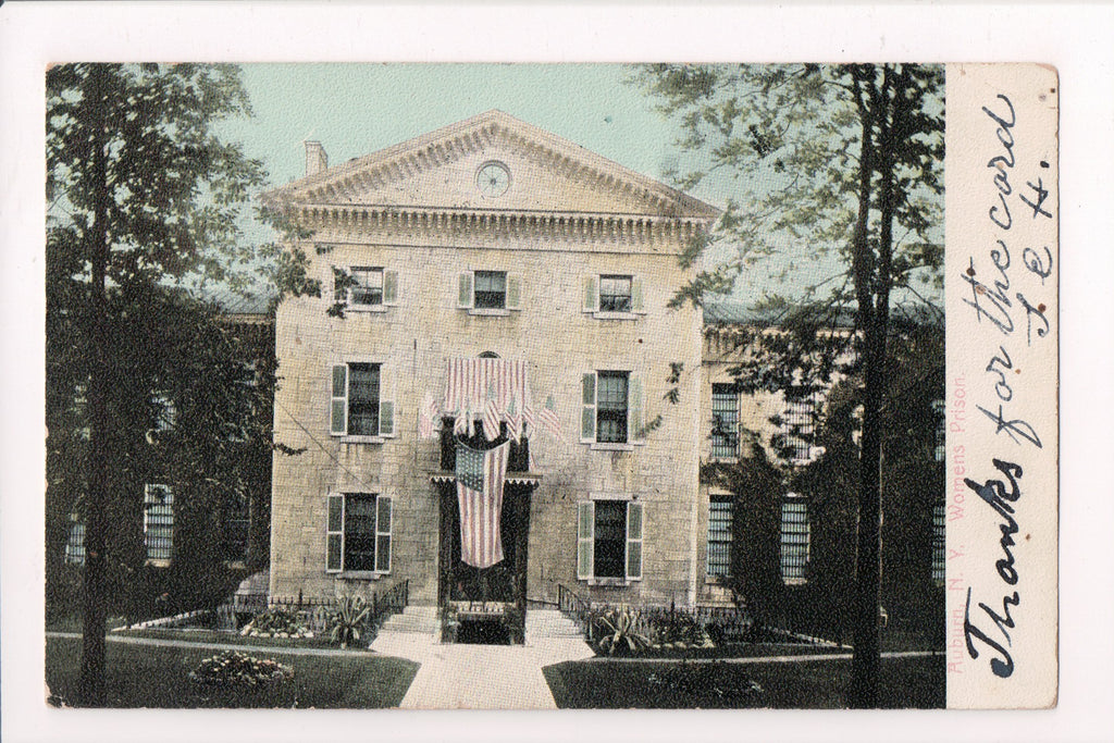 NY, Auburn - Womens Prison, flags draping door - T J Hennessey card - w02624