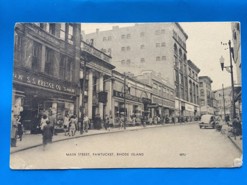 RI, Pawtucket - Main Street with store signs postcard - 800194