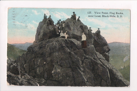 SD, Lead - Black Hills, Flag Rocks with people on point - CP0642