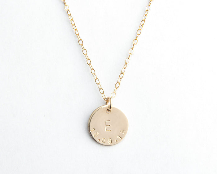 gold round disc initial date necklace pixley pressed
