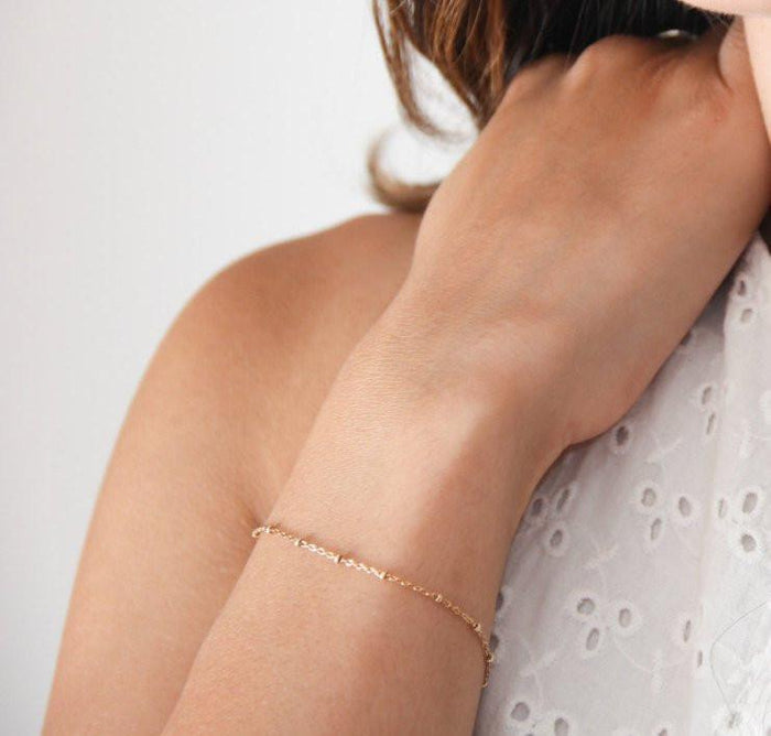 gold satellite chain bracelet pixley pressed