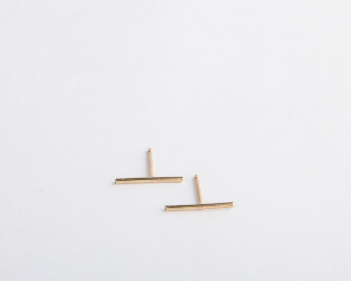long gold line bar earrings pixley pressed