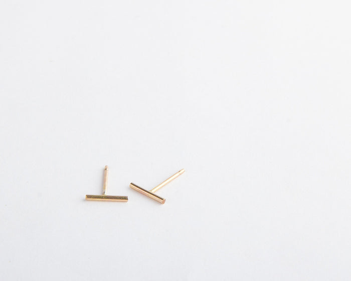 gold short line bar earrings