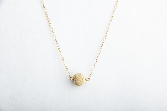 shimmery gold stardust necklace pixley pressed