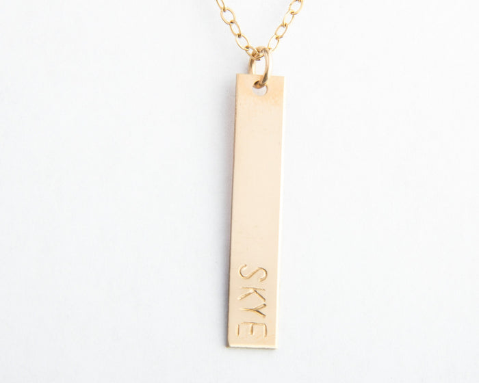 vertical gold bar name necklace pixley pressed