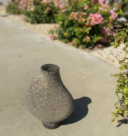 Asymmetrical beaded vase