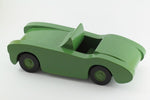 Handcrafted wooden toy car in green