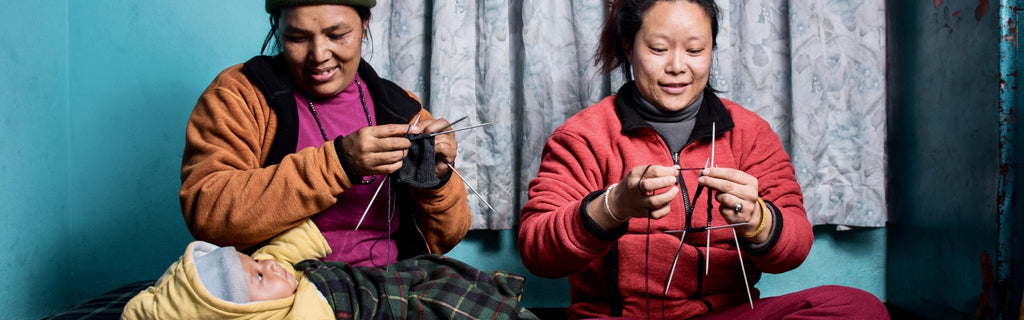 Dinadi women hand knitting our winter warmers, dignified work