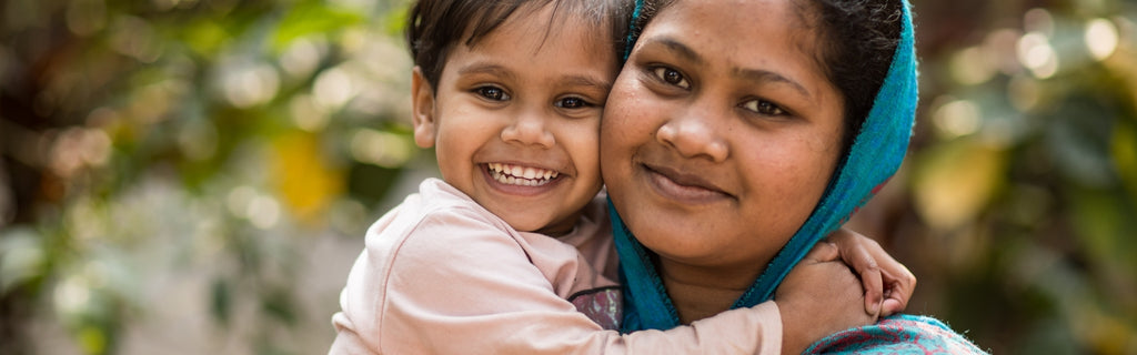 Basha woman with her daughter, finding freedom from exploitation in dignified work