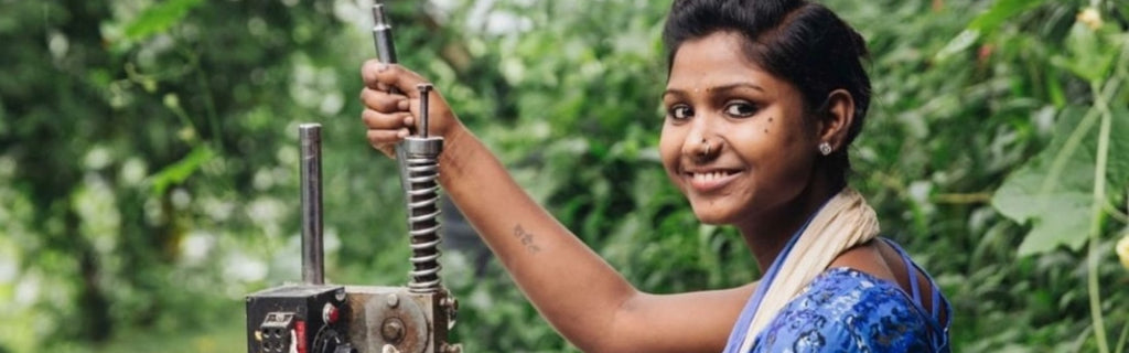Joyn's worker using her hands to help reduce the impact of manufacturing on her environment