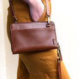 Brown leather wallet with crossbody strap by JOYN