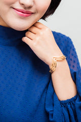 Gold bangle by Starfish project, available at For Dignity Australia