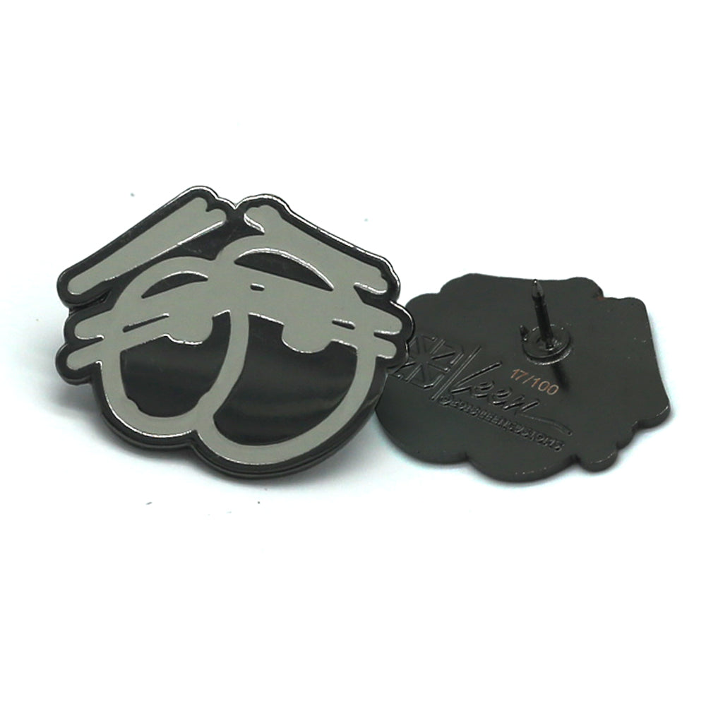 TRAV EYES LAPEL PIN