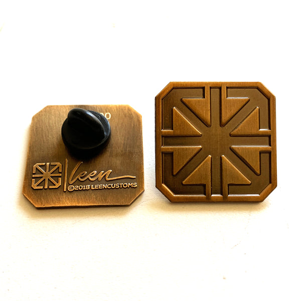 TSL ICON LAPEL PIN / BRASS ON ANTIQUED BRASS EDITION
