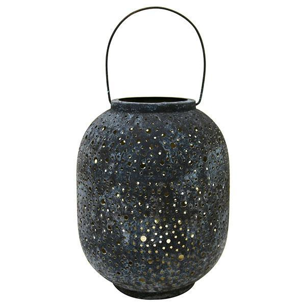 eroded brass lantern round shape slightly blckish blueish outside golden inside with dots holes night sky effect decorative beautiful at dark latern messing öösinine mustjas dekoratiivne