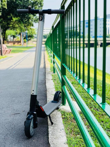 electric scooter against railing