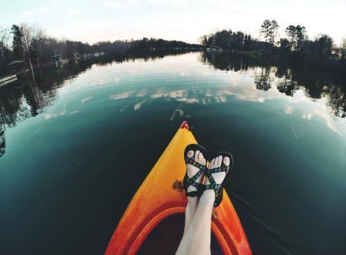 Feet on a kayak on a lake