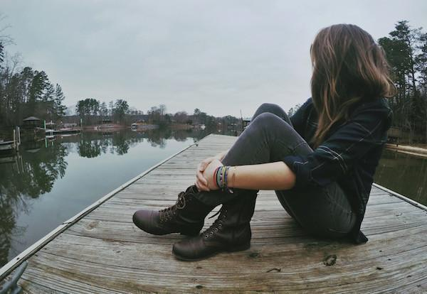 Girl on dock—Finding Strength in Vulnerability Emotional Care® Blog