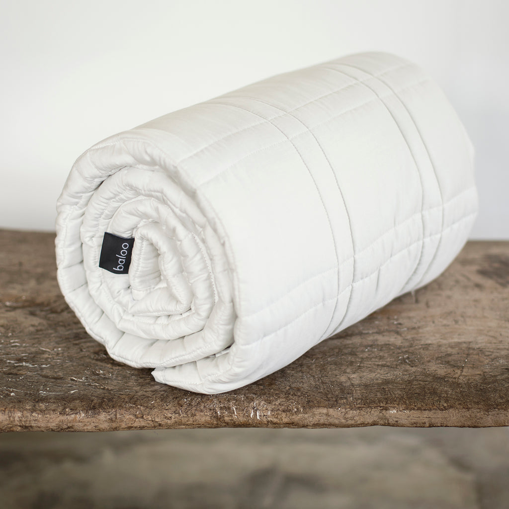 White Baloo weighted blanked rolled up