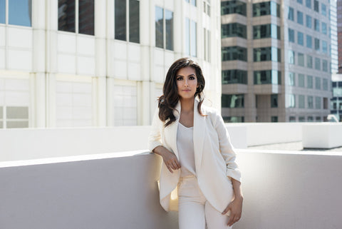 Dr Nadia Musavvir in all-white outfit in a city
