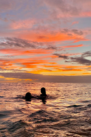 Oahu, Hawaii Sunset Picture with two people in the water