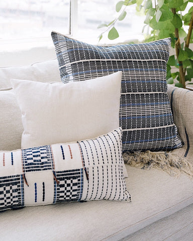 Woven pillows with white and blue motifs