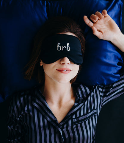 woman sleeping with brb unisex silk blackout sleeping mask