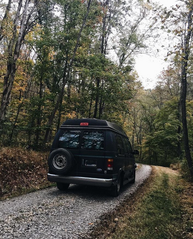Rear view of van on a forest path